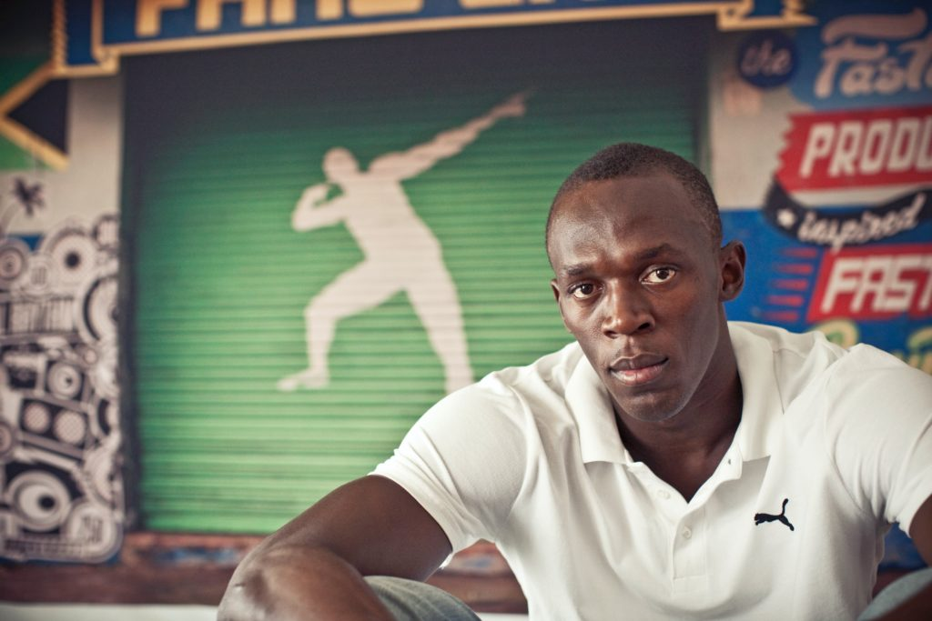 bolt running puma brand sport shooting photo Kingston